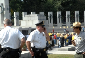Park Police stand by as the veterans push their way to THEIR memorial.